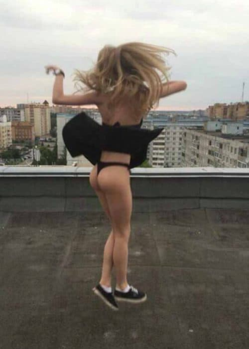 Kayley jumping up with black skirt flying up showing her black panties 3.