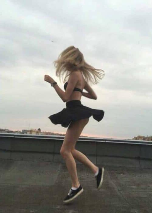 Kayley jumping up with black skirt flying up showing her black panties 2.