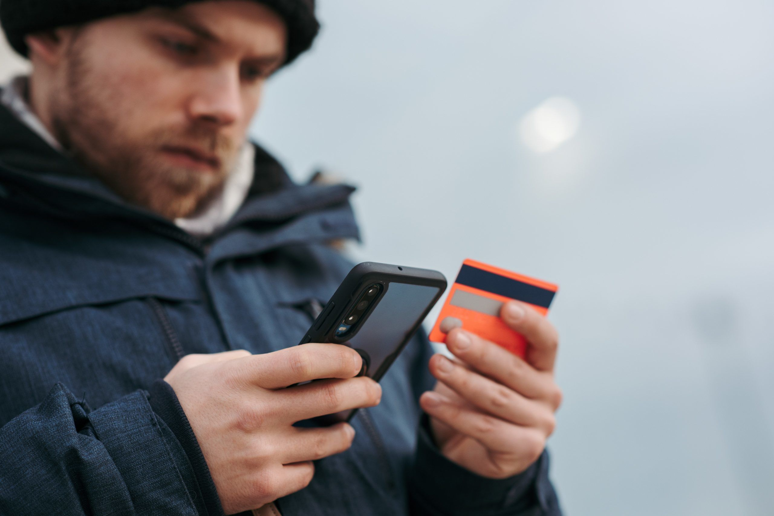 man-purchasing-on-phone-scaled